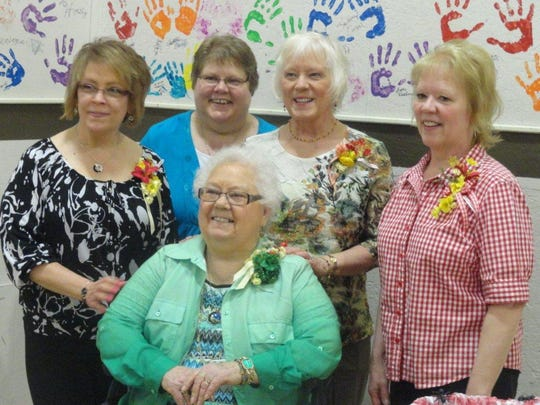 In this 2013 photo, Bettye Nall, center, poses for