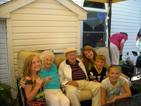 From left to right, my cousin Kylie Taylor, great-grandma and grandpa Almeda and Merle Royston, me, and cousins Hunter and Allie Taylor pose at a family birthday party in 2010. I love my family, but writing about them makes me nervous. I hope my words do them justice.