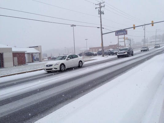 Residents drive carefully during Sunday's storm