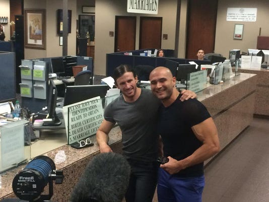 Yairo Herrera and Luke Karam were the first couple to obtain their marriage license at the County Clerk's Office.