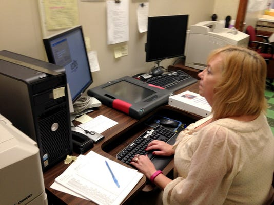 Lori Olilver, Lebanon County Director of Voter Registration and Elections, work in her office at the Lebanon Municipal Building.