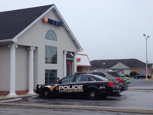 A police car sits in front of the PNC Bank in Littlestown on Sept. 29.