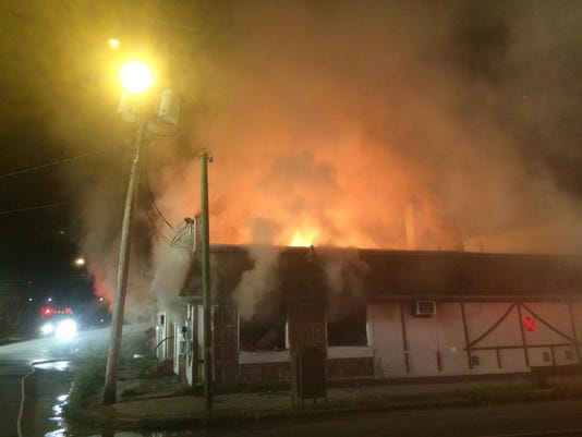 Heavy fire surged through the roof of the former Manor Club building in York early in the morning on Aug. 6, 2015.