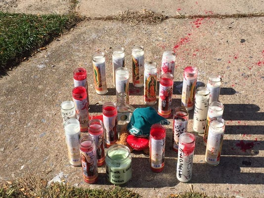 Candles now at the scene of a Saturday shooting in York.