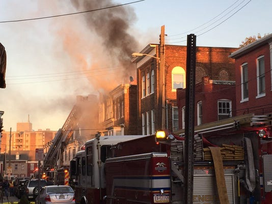 Firefighters work on a fire in the 300 block of East Poplar on Wednesday.