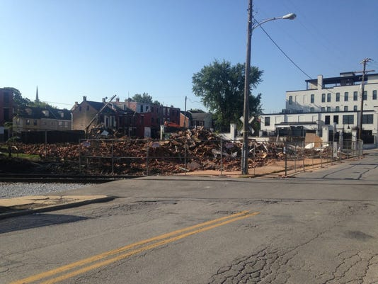 Think Loud's headquarters -- the white building -- can be seen at right. (Mark Walters - Daily Record/Sunday News)