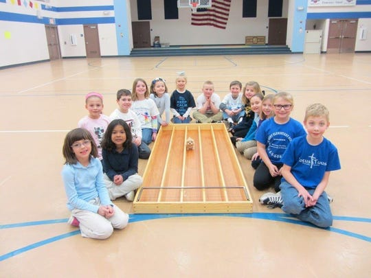 The second-grade classroom at St. Mary Elementary School in Neenah was the winner of the mechanical dog races. Pictured are (clockwise, from left) Anne Walsh, Makayla Klessig, Meagan Mccune, Presten Short, Hope Dunaway, Haylie Lynch, Adel Schneider, Jack Chevalier, Zach Beyer, Mary Mccurdy, Lorelai Sonnenburg, Breelyn Pauly, Haley Quimby and Peter Krautkramer.