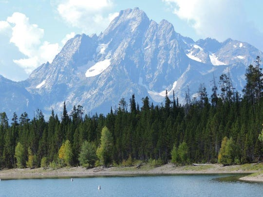 Grand Teton National Park was established by an act of Congress in 1929. Many of the mountains in the park have long been covered by snow and glaciers all year.