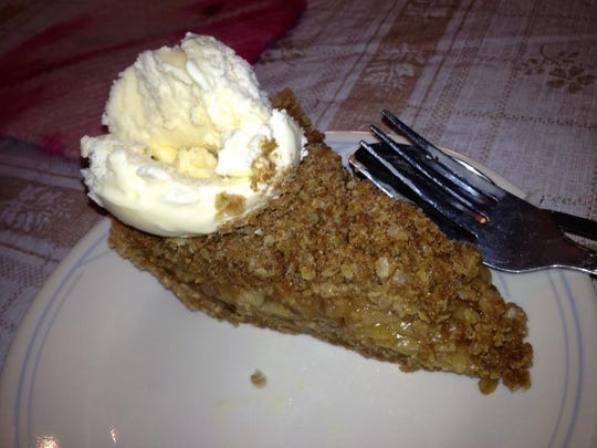 There are many variations of Dutch apple pie among the Amish. This one is served with a scoop of ice cream, while Gloria's has a glaze.