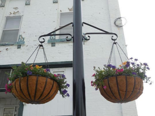 Among the many things grown at the Indianola greenhouses are hanging baskets for The Square.