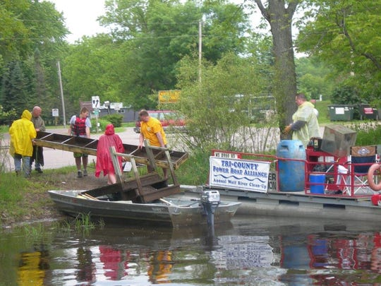 The members Tri-County Powerboat Alliance held their annual river clean up on June 14. Volunteers removed steel drums, various buckets, metal and garbage hazards from the Wolf River and its shores. The group hired barges to remove partially or fully submerged large trees, logs and deadheads from the main river channel. All of these items can be a danger to boaters.