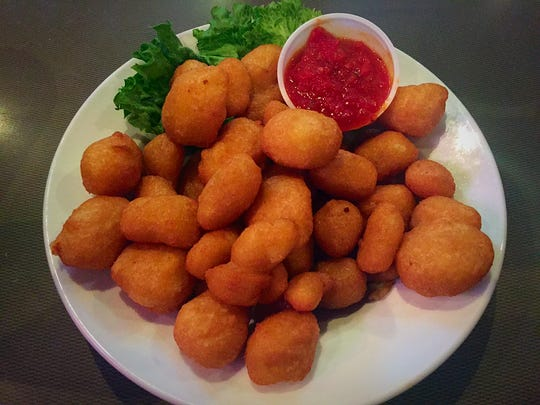The Cheese Balls ($6.99) feature battered cheddar cheese and marinara.