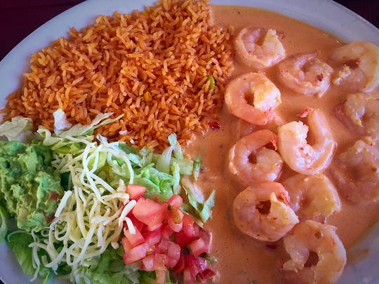 The Chipotle Shrimp ($11.99) is a savory dish full of the smokey flavor of the chipotle peppers in a smooth cream sauce. It also is served with guacamole, rice, tomatoes, lettuce and cheese.