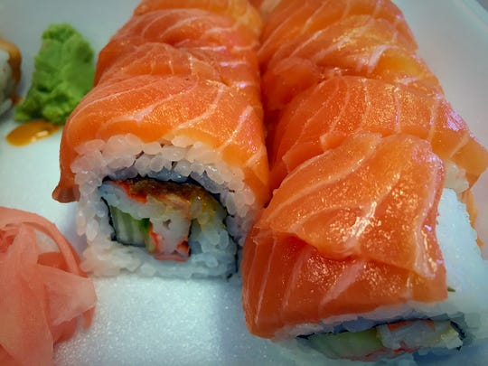 The Alaskan roll ($9.50) features spicy crab, cucumber, crunchies and scallions. It is topped with salmon.