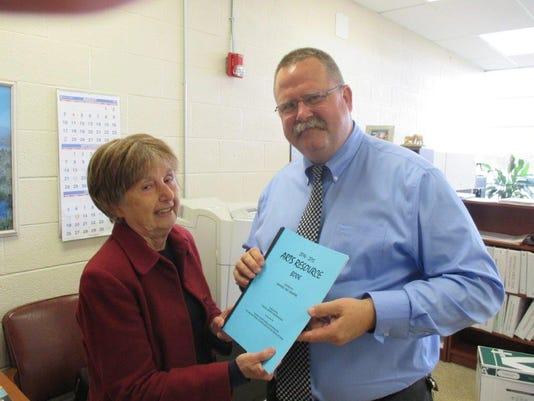 Superintendent Gets Book.jpg