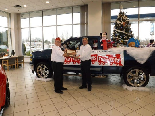 Don Dashner, left,from the Marine Corp League presents Dan Falk, general manager of Moran Chevrolet in Fort Gratiot, with The Marine Corp Reserve Certificate of Appreciation award for an outstanding Toys For Tots collection at the dealership this year. All of the employees along with customer support helped fill a vehicle with toys.