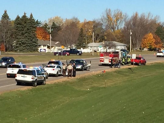 Emergency workers were on the scene of crash Saturday morning in western St. Cloud. One man was detained by police nearby at the Sauk River bridge on Veterans Drive.