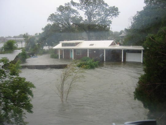 Water surrounds the home of Debbie Miller and husband Gary Chiaverotti on Sept. 18, 2003 in Norfolk, Virginia during Hurricane Isabel.