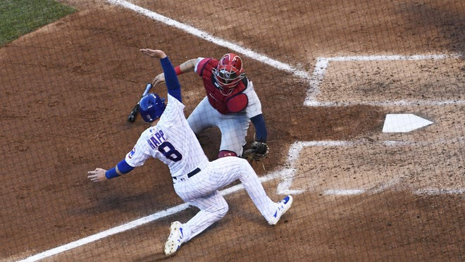 St. Louis Cardinals catcher Andrew Knizner (7) tags out Chicago Cubs' Ian Happ (8) at home plate during the third inning of Game 2 of a baseball doubleheader, Wednesday in Chicago.