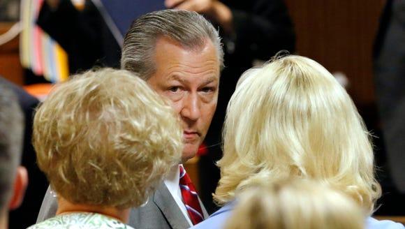 Former Alabama House Speaker Mike Hubbard looks toward