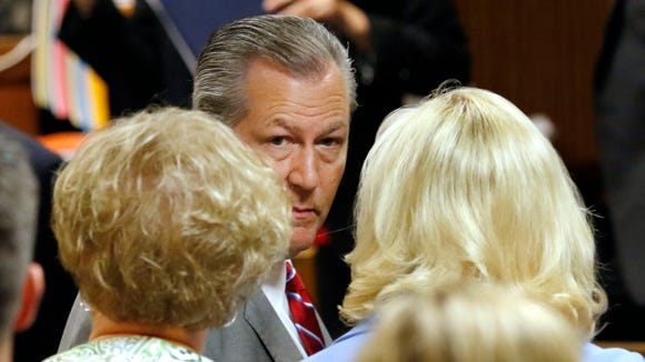 Former Alabama House Speaker Mike Hubbard looks toward his family after he was sentenced to to four years in prison and another eight on probation for breaking the state ethics law, Friday, July 8, 2016, in Opelika, Ala. (Todd Van Emst/Opelika-Auburn News via AP, Pool)