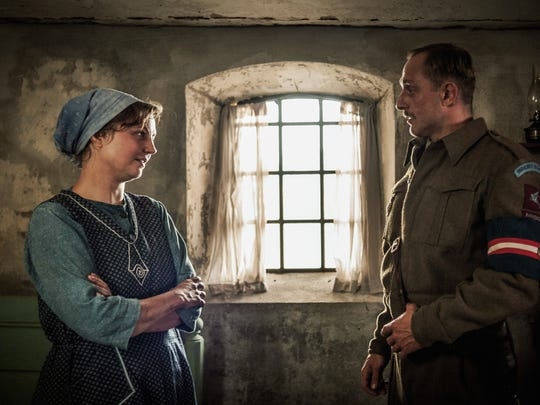 "Sgt. Carl Rasmussen (Roland Møller)  strikes up a relationship with Karin (Laura Bro) in ""Land of Mine."""
