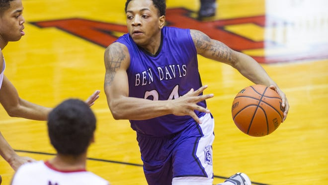 Ben Davis High School senior DeShon Tate (24) makes a move to the lane during second half action. North Central High School hosted Ben Davis High School in boys varsity basketball action, Friday, Jan. 9, 2015. Ben Davis defeated North Central 51-50.