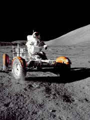 In this December 1972 photo provided by NASA, Apollo 17 commander Eugene Cernan makes a short checkout of the Lunar Roving Vehicle on the moon.