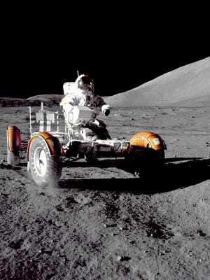 In this December 1972 photo provided by NASA, Apollo 17 commander Eugene Cernan makes a short checkout of the Lunar Roving Vehicle on the moon. NASA announced that former astronaut Cernan, the last man to walk on the moon, died Monday, Jan. 16, 2017.