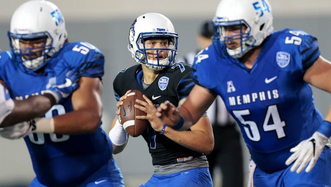 Memphis quarterback Brady Davis looks for an open man downfield during the Tigers'  annual spring scrimmage at the Liberty Bowl Friday Night.