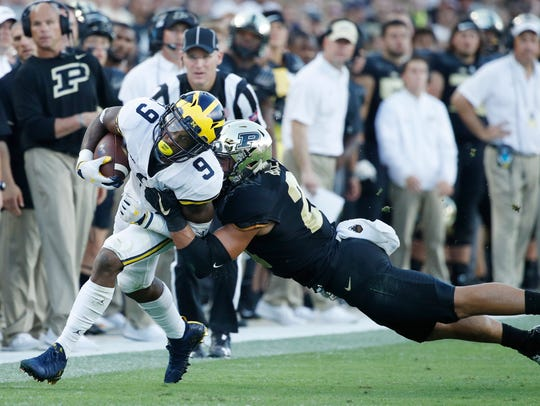 Donovan Peoples-Jones is tackled by Markus Bailey after