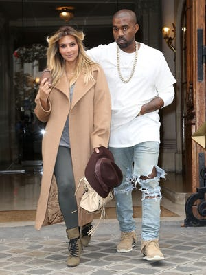 Kim Kardashian and Kanye West stroll on the 'Avenue Montaigne' on Sept. 28, 2013 in Paris.