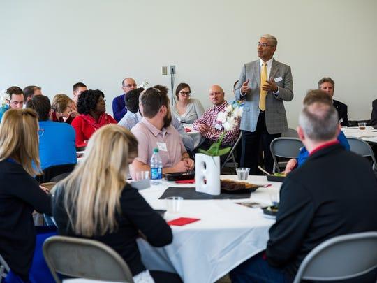 Venky Venkatachalam, dean of the University of South Dakota Beacom School of Business addresses as a recent MBA residency luncheon.