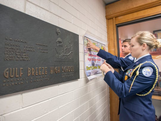 "Air Force Junior ROTC Cadet Lt. Col. Grace Overholtz, right, and Cadet Chief Master Sergeant Kyle Muldoon hang a ""Don't Drive Distracted"" poster in Gulf Breeze High School on Thursday, November 9, 2017.  The seniors created the ""Don't Drive Distracted"" campaign to help lessen the amount of vehicle accidents that occur along the stretch of Gulf Breeze Blvd.  that predominantly occur before and after school."