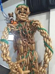 A wearable Groot balloon sculpture made by Tim Thurmond, the Balloon Sculptor.