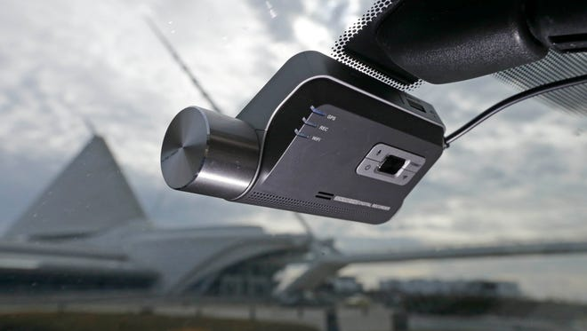 The Thinkware Dash Cam F800 adheres to the windshiled under the rearview mirror.  The popularity of dash cams has increased recently.