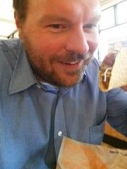 Chad Birger loves Taco John's tacos. He loves them