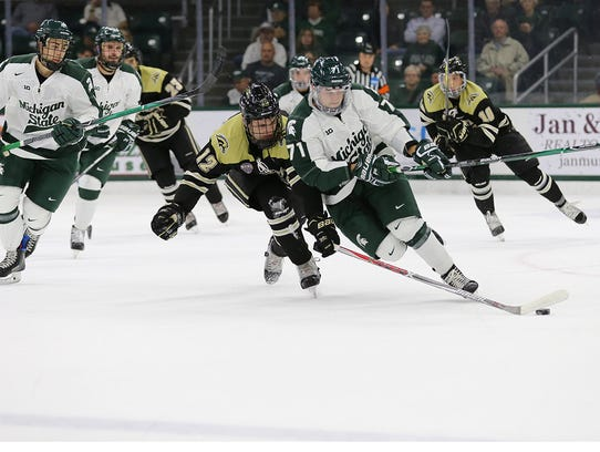 MSU's Logan Lambdin chases the puck during the Spartans'