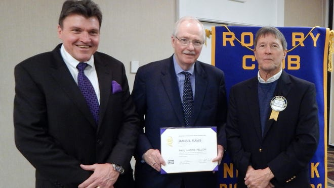 Recently retired Corning Inc. Vice Chairman  James Flaws, center, accepts a Paul Harris Fellowship from Coring Rotary President Buddy Cutler, left, and Paul Harris Fellow committee head Les Rosenbloom.