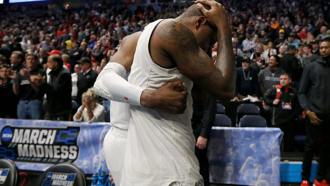 Cincinnati Bearcats forward Gary Clark (11) returns to the locker room after the NCAA Tournament Second Round game between the Cincinnati Bearcats and the Nevada Wolf Pack at Bridgestone Arena in Nashville on Sunday, March 18, 2018. The 2-seeded Bearcats were eliminated from the tournament by the Wolf Pack with a 75-73 loss.