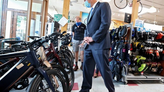 Gov. Charlie Baker toured Belmont WheelWorks bicycle shop on Tuesday with owner Peter Mooney to highlight the sales tax holiday taking place this weekend.