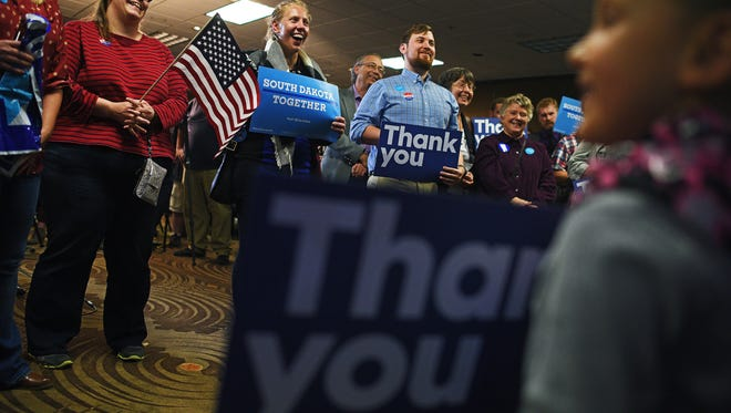 Party-goers look on as Jay Williams, Democratic candidate for U.S. Senate, delivers his concession speech during the South Dakota Democratic Party's Election Night event Tuesday, Nov. 8, 2016, at the Holiday Inn Sioux Falls City Centre in downtown Sioux Falls.