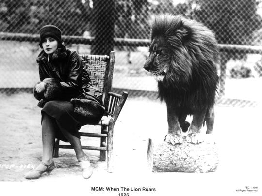Sports photographer Don Gillum, under contract with MGM to photograph their stars. Garbo was a budding star when she posed with Jackie the Lion, known as Leo the Lion, MGM's mascot. Garbo moved to the farthest edge of the Old Hickory chair. 1926 photo