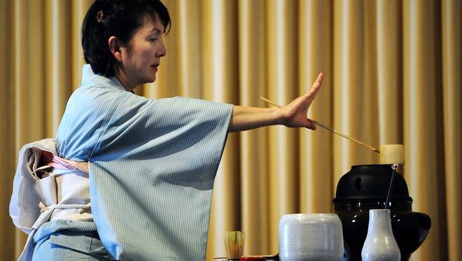 A traditional tea ceremony is demonstrated to an audience in the Hondo Chapel during Sunday's Obon Festival at the Buddhist Temple of Salinas. Photo taken on 7/26/09 in Salinas .