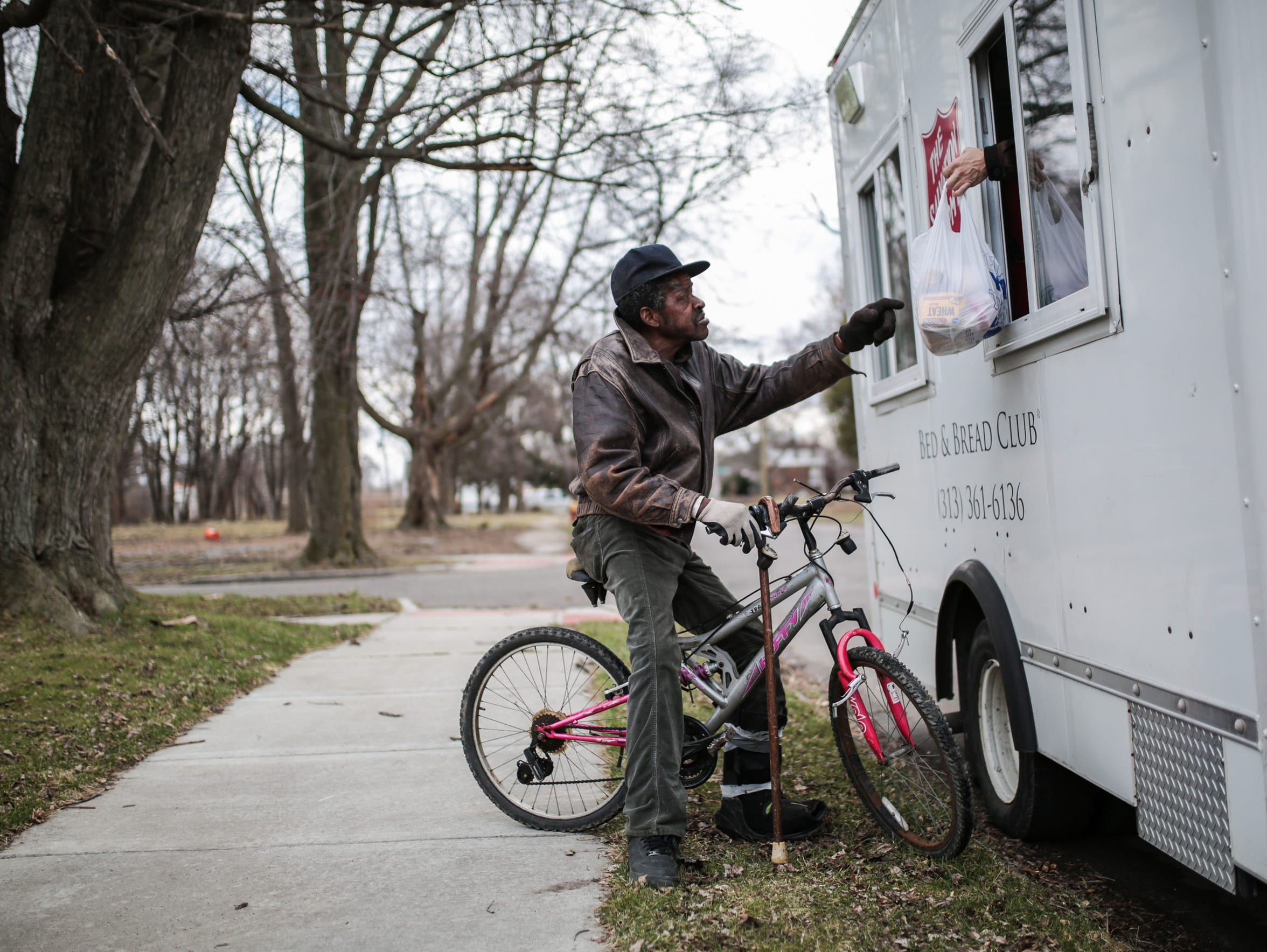 Vincent Bean, 62, of Detroit, rides his bike back home