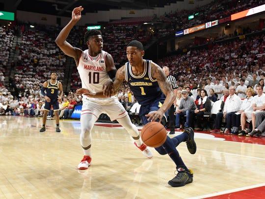 Michigan guard Charles Matthews drives to the basket on Maryland guard Darryl Morsell on Saturday.