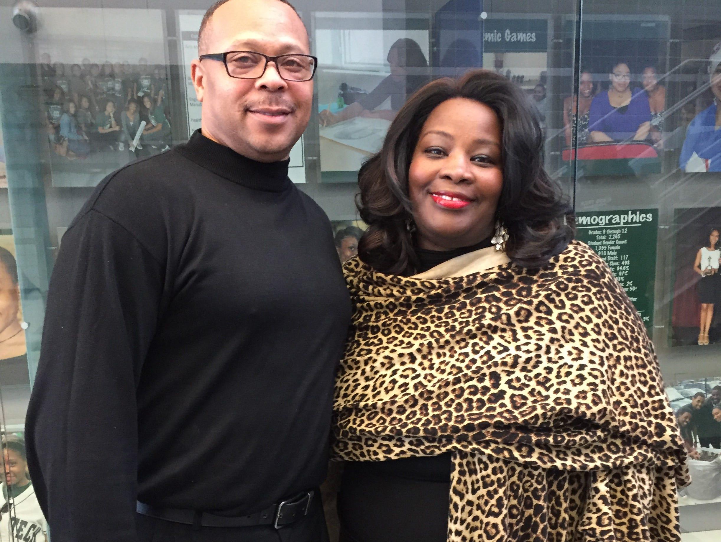 Detroit Cass Tech football coach Thomas Wilcher with school principal Lisa Phillips at Cass Tech in December 2016.