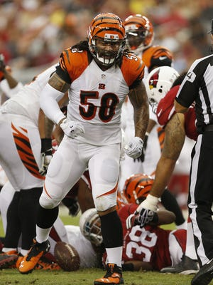 Cincinnati Bengals middle linebacker Rey Maualuga (58) reacts after a stop in the first quarter against the Arizona Cardinals running back Andre Ellington (38) at the University of Phoenix Stadium.