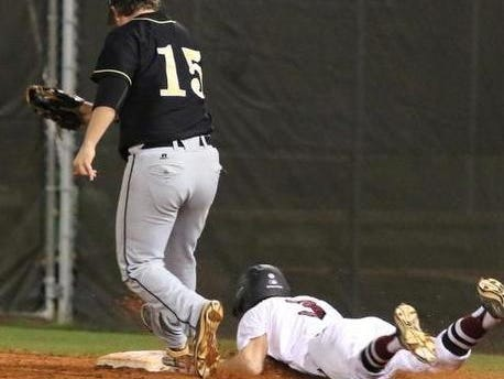 Tate's Josh Kea slides into first during Tate's win over Milton in the Aggie Classic championship. Tate and Milton will face again tonight in the second round of the playoffs.