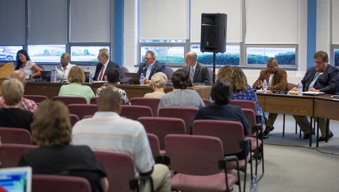 Members of the public listen to the school board during the first meeting of the Ball State University appointed MCS school board on July 16 at the Muncie Area Career Center. The new members are planning to hold the monthly meetings at different locations through the year.